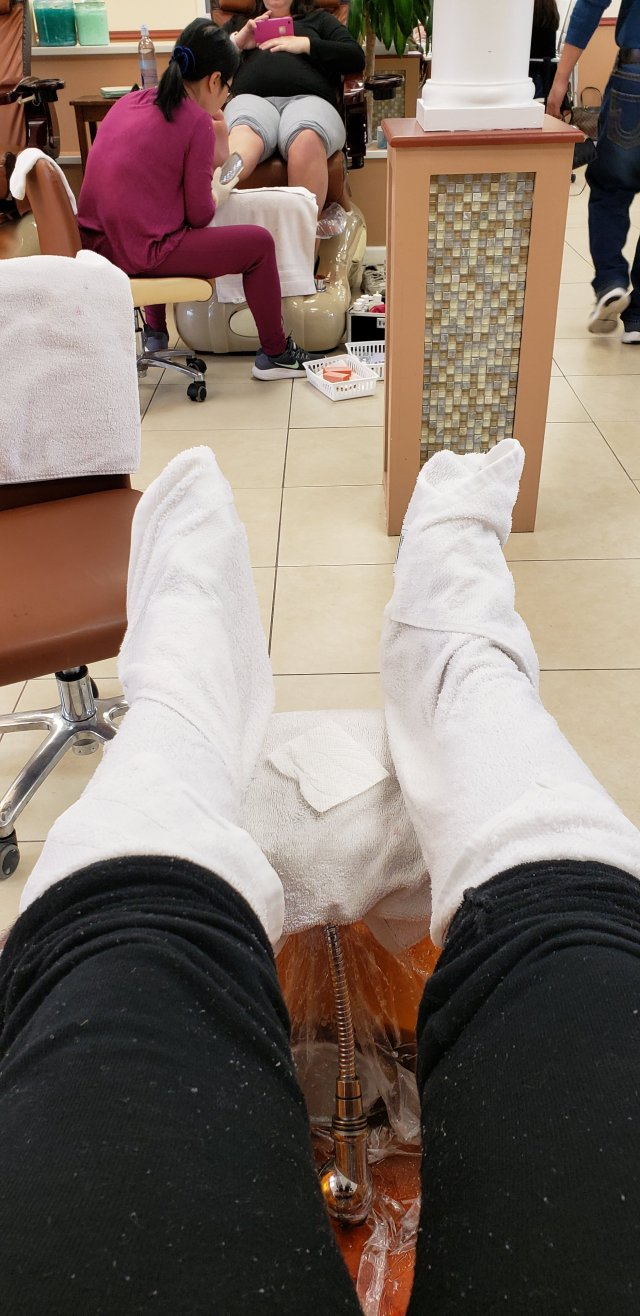 Pedicure with hot towel massage